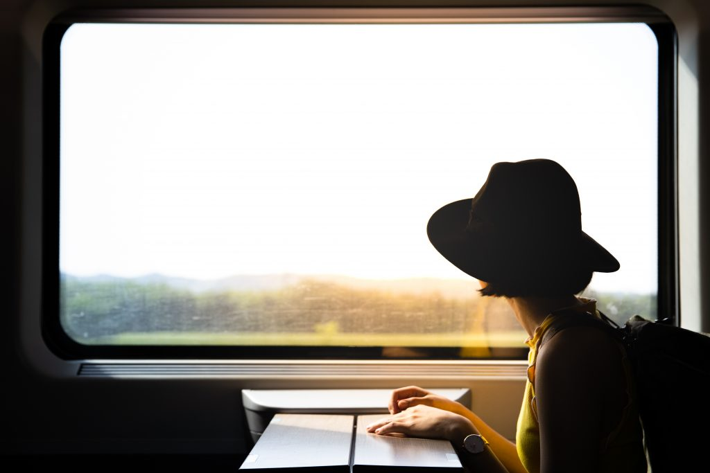 A,Beautiful,Hipster,Asian,Woman,Travelling,On,The,Train.,Sitting