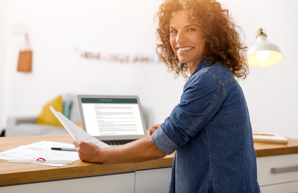 Middle,Age,Woman,At,The,Office,Working,With,A,Laptop
